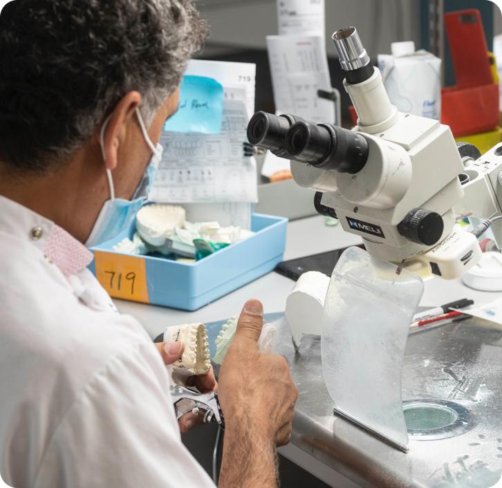 denturist in a lab working on a new set of dentures