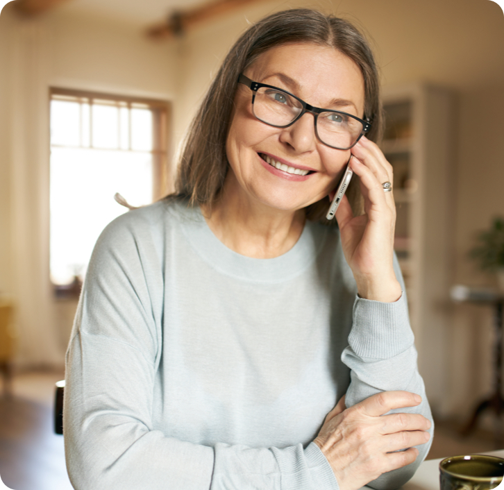 middle aged woman smiling while talking on the phone