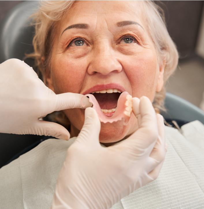 a patient havin gtheir dentures put in by the denturist